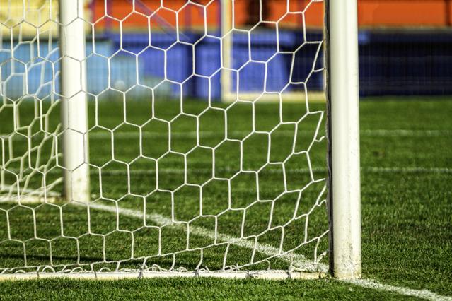Football soccer goal net and grass.